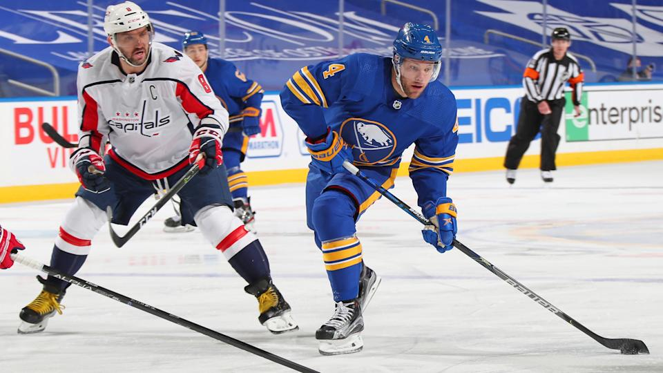 BUFFALO, NY - MARCH 15: Taylor Hall #4 of the Buffalo Sabres controls the puck against Alex Ovechkin #8 of the Washington Capitals during an NHL game on March 15, 2021 at KeyBank Center in Buffalo, New York. (Photo by Bill Wippert/NHLI via Getty Images)