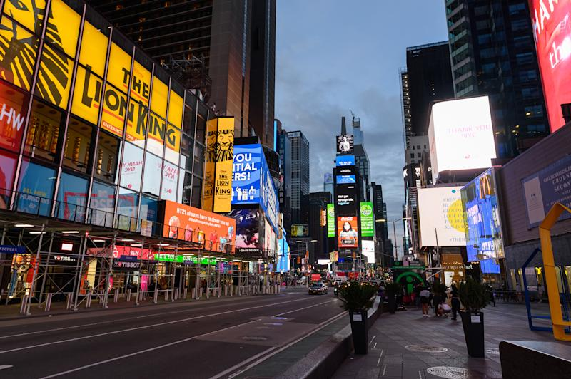 NEW YORK, NEW YORK - MAY 27: A view of billboards in Times Square during the coronavirus pandemic on May 27, 2020 in New York City. Government guidelines encourage wearing a mask in public with strong social distancing in effect as all 50 states in the USA have begun a gradual process to slowly reopen after weeks of stay-at-home measures to slow the spread of COVID-19. (Photo by Noam Galai/Getty Images)