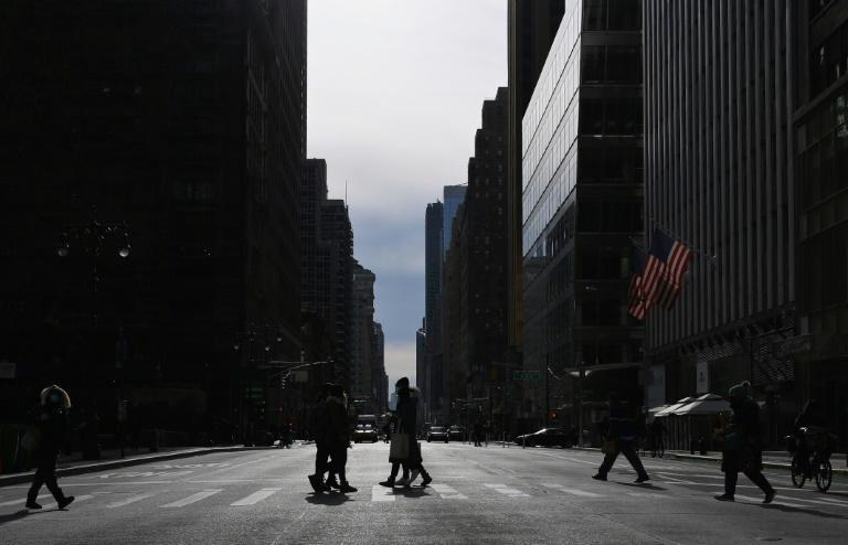 In the pre-Covid-19 era the streets of midtown Manhattan would be teeming with people - but now New York's famous business districts are struggling to survive