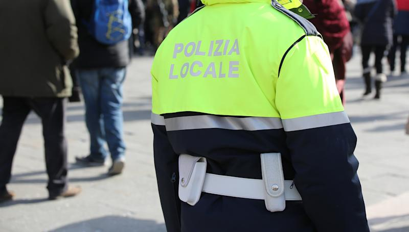 Policeman with uniform and the text POLIZIA LOCALE that meas Local Police in Italian language