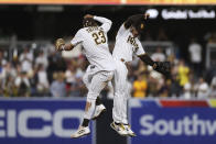 San Diego Padres' Trent Grisham, right, celebrates with Fernando Tatis Jr. after the Padres defeated the Oakland Athletics in a baseball game Tuesday, July 27, 2021, in San Diego. (AP Photo/Derrick Tuskan)