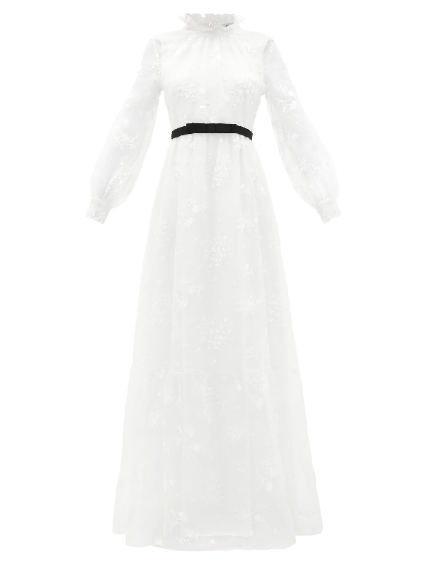 """<p><strong>ERDEM</strong></p><p>modesens.com</p><p><strong>$6480.00</strong></p><p><a href=""""https://modesens.com/us/en/product/erdem-clementine-floralembroidered-organza-gown-white-18270605/?refinfo=gSH_ggfErdemfc-ApAcClDr18270605"""" rel=""""nofollow noopener"""" target=""""_blank"""" data-ylk=""""slk:SHOP NOW"""" class=""""link rapid-noclick-resp"""">SHOP NOW</a></p><p>Opt for full Victorian vibes with a ruffed high collar neckline and puff sleeves. Small details, like a black grosgrain belt, give you options when it comes to styling. Invest in black evening shoes you'll wear for ages, rather than another pair in ivory.</p>"""