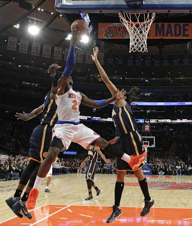 New York Knicks guard J.R. Smith (8) goes up for a layup double-teamed by Indiana Pacers defenders in the first half of their NBA basketball game at Madison Square Garden in New York, Wednesday, Nov. 20, 2013. (AP Photo/Kathy Willens)