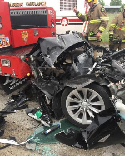 The Tesla Model S is seen after it hit the back of a firetruck in South Jordan, Utah.