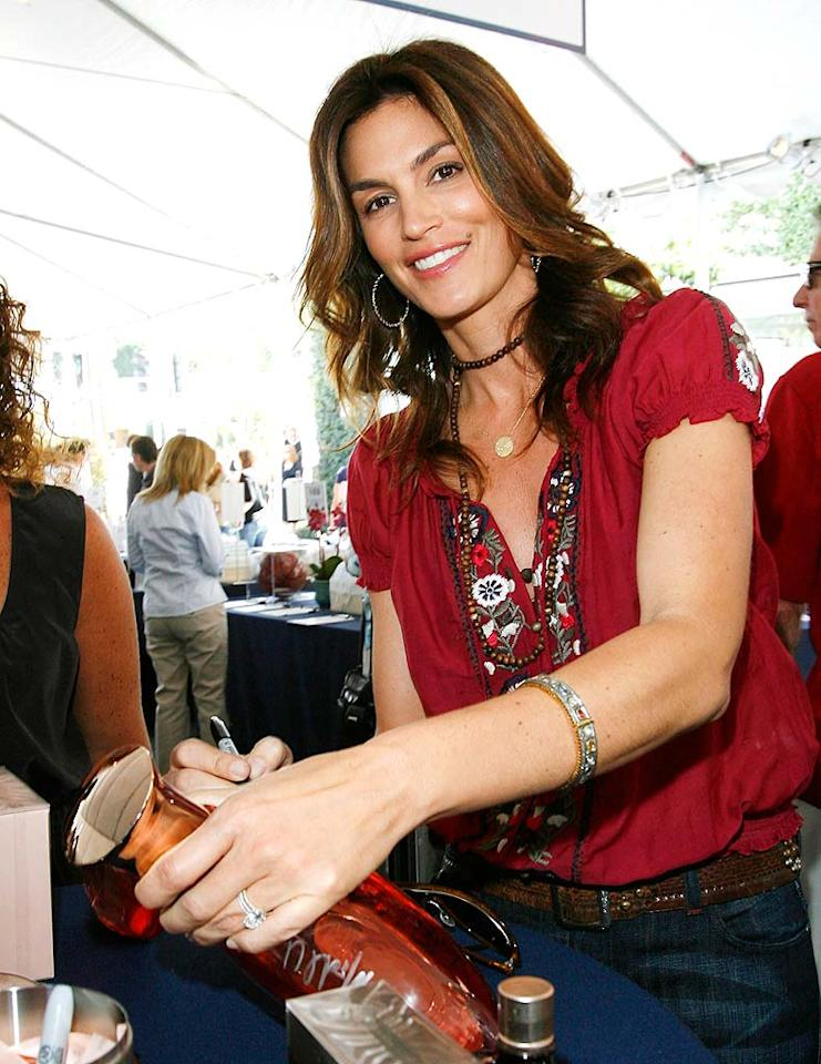 """The supermodel autographs a giant bottle of John Varvatos fragrance which will be auctioned off for charity. Donato Sardella/<a href=""""http://www.wireimage.com"""" target=""""new"""">WireImage.com</a> - March 9, 2008"""