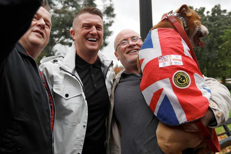 Former leader of the English Defence League, Tommy Robinson, joins football fans as they gather at Park Lane (REUTERS)