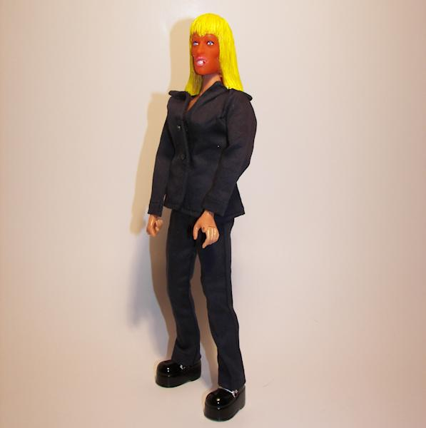 """This undated photo provided by HeroBuilders shows the novelty company's new """"tanorexic"""" action figure based on Patricia Krentcil, the deeply tanned New Jersey mother accused of causing skin burns to her young daughter in a tanning booth. (AP Photo/HeroBuilders)"""