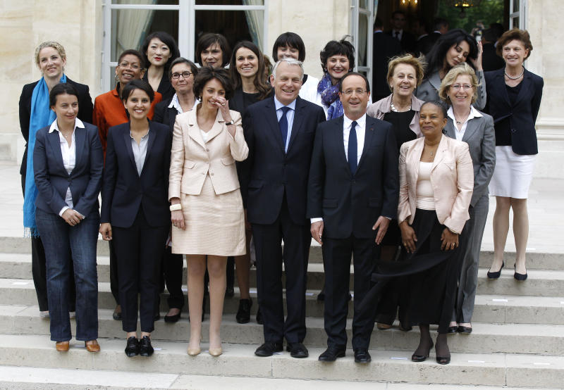 French President Francois Hollande, second right, and Prime Minister Jean-Luc Ayrault, center, pose with women of the cabinet after the first weekly cabinet meeting Thursday, May 17, 2012 at the Elysee Palace in Paris. First row from the left: Housing Minister Cecile Duflot, Women's Rights minister Najat Vallaud-Belkacem, Social Affairs Minister Marisol Touraine, Justice Minister Christiane Taubira, right. second row from the left: Deputy Justice Minister delphine Batho, Deputy Education Minister George Pau-Langevin, Sports Minister Valerie Fourneyron, Culture Minister Aurelie Filippeti, Family Affairs Dominique Bertinotti, State Labor Minister Marylise Lebranchu, Environment Minister Nicole Bricq. Top from the left: Minister for Small Business and the Digital Economy Fleur Pellerin, Deputy minister in charge of French citizen living abroad and French speaking countries Yamina Benguigui , second right, and Ederly People Minister Michele Delaunay. (AP Photo/Michel Euler)