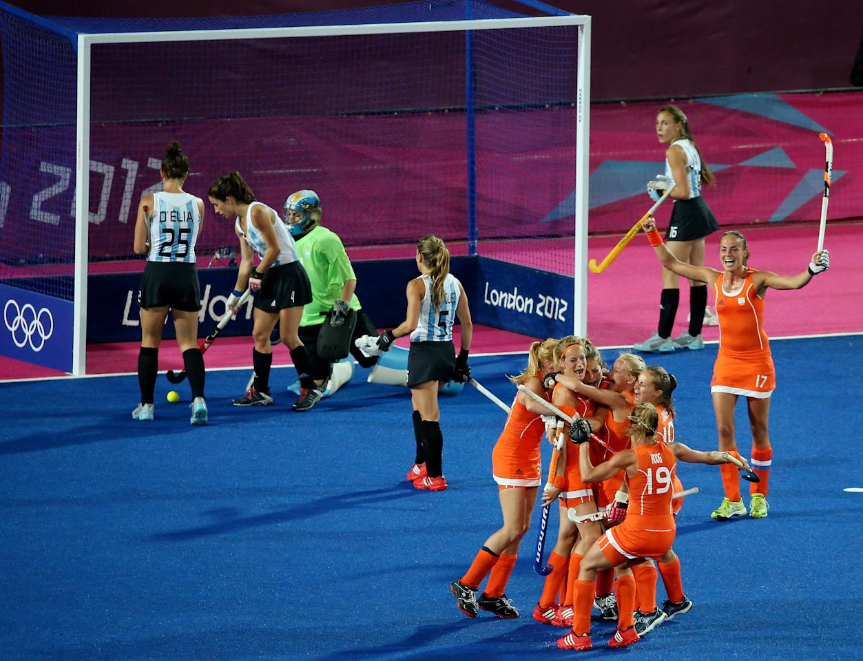 LONDON, ENGLAND - AUGUST 10:  Carlien Dirkse Van Den Heuvel #9 of Netherlands celebrates with her teammates after scoring a goal in the second half against Argentina during the Women's Hockey gold medal match on Day 14 of the London 2012 Olympic Games at Hockey Centre on August 10, 2012 in London, England.  (Photo by Daniel Berehulak/Getty Images)