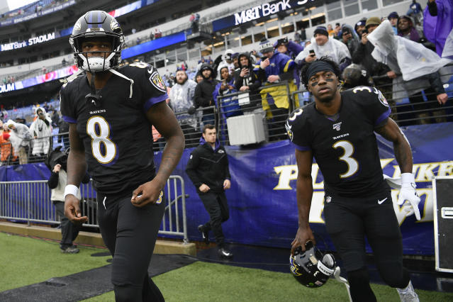 Baltimore Ravens quarterbacks Lamar Jackson, left, and Robert Griffin III, right, take the field to begin warming up before the start of an NFL football game against the San Francisco 49ers, Sunday, Dec. 1, 2019, in Baltimore, Md. (AP Photo/Nick Wass)