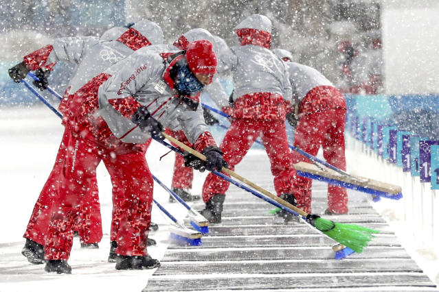 <p>Course workers clear the snow off of the shooting range during the Women's 4x6km Biathlon Relay at the 2018 Winter Olympics in PyeongChang, South Korea, Feb. 22, 2018.<br> (AP Photo/Andrew Medichini) </p>