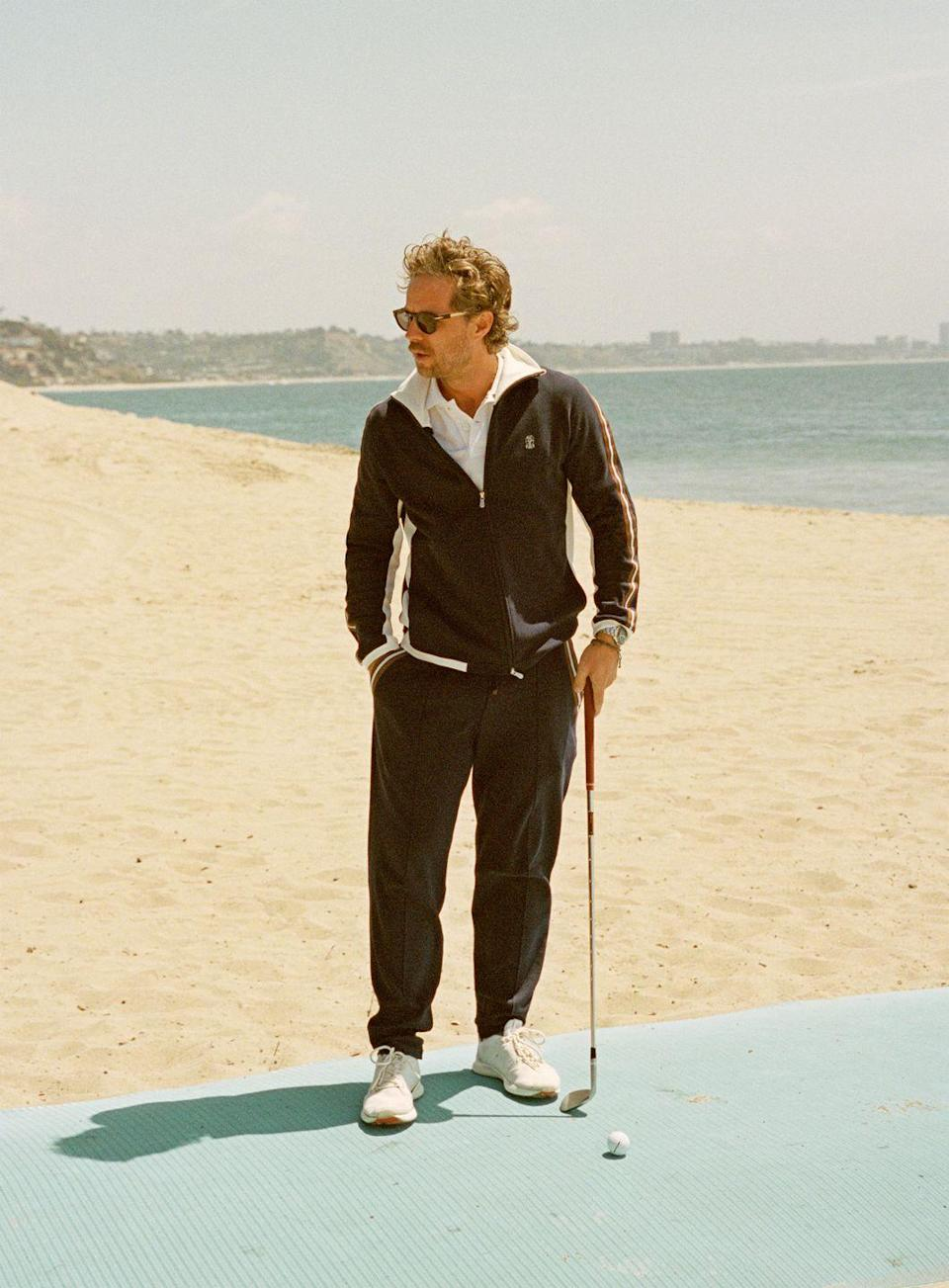 """<p>Like we said, it's not all polos and trousers now. A tracksuit on the course is welcome, so long as it's as put-together as this one. </p><p><em>Jacket, polo, and trousers by Brunello Cucinelli.</em></p><p><a class=""""link rapid-noclick-resp"""" href=""""https://shop.brunellocucinelli.com/en-us/"""" rel=""""nofollow noopener"""" target=""""_blank"""" data-ylk=""""slk:Shop Brunello Cucinelli"""">Shop Brunello Cucinelli</a></p>"""