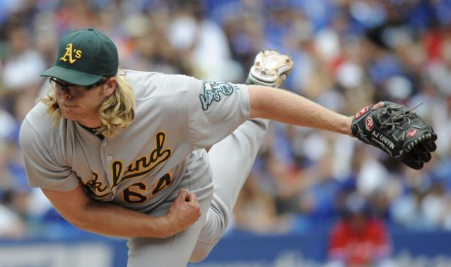 Oakland Athletics pitcher A.J. Griffin throws against the Toronto Blue Jays during the third inning of a baseball game on Sunday, Aug. 11, 2013, in Toronto. (AP Photo/The Canadian Press, Jon Blacker)