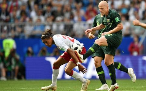 Denmark's forward Yussuf Poulsen (L) tangles with Australia's midfielder Aaron Mooy (R) during the Russia 2018 World Cup Group C football match between Denmark and Australia at the Samara Arena in Samara on June 21, 2018 - Credit: AFP
