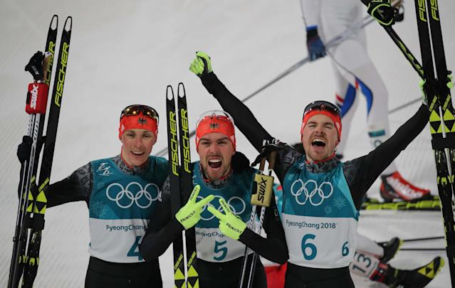 Nordic Combined Events - Pyeongchang 2018 Winter Olympics - Men's Individual 10 km Final - Alpensia Cross-Country Skiing Centre - Pyeongchang, South Korea - February 20, 2018 - Gold medalist, Johannes Rydzek of Germany, silver medalist, Fabian Riessle of Germany and bronze medalist Eric Frenzel of Germany celebrate. REUTERS/Carlos Barria