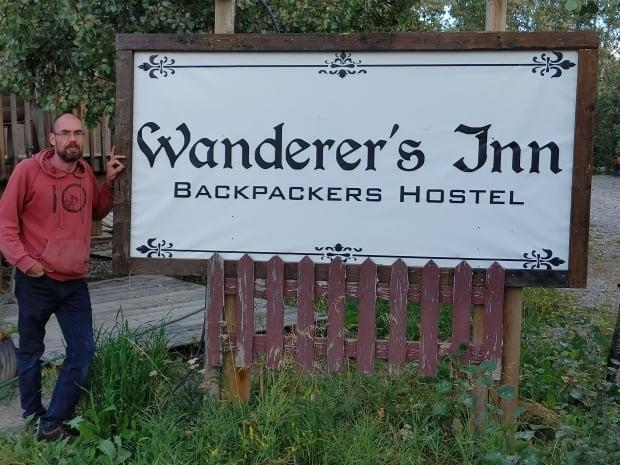 Martin Laniel said he's now asking guests for proof of vaccination before checking them in to his Wanderer's Inn backpackers hostel in Haines Junction, Yukon. An exposure notice was issued for his hostel earlier this week. (Submitted by Martin Laniel - image credit)