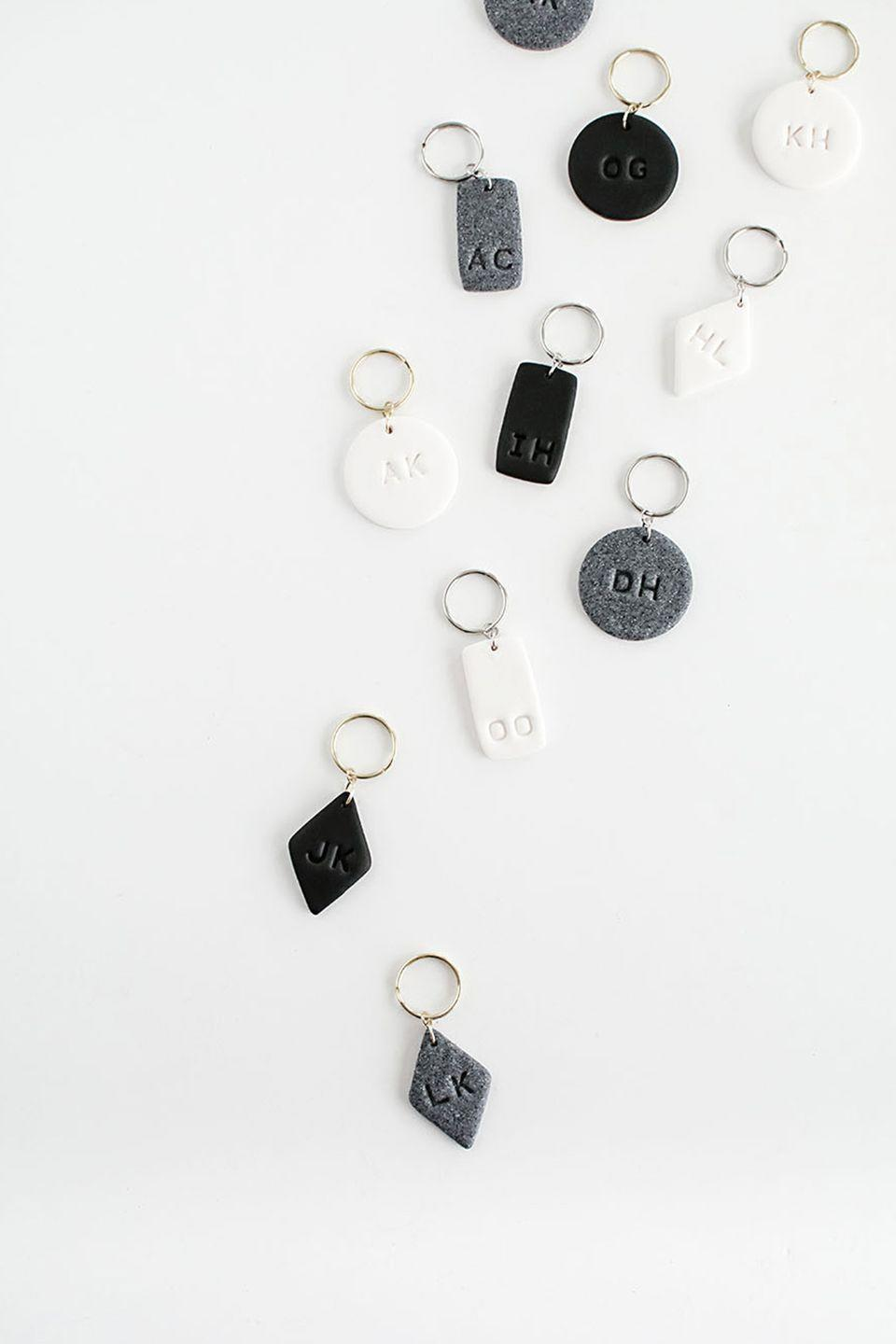 """<p>These stylish, modern keychains add a touch of cool to mom's car keys and can be customized with her initials or the initials of all her kids.<br></p><p><a class=""""link rapid-noclick-resp"""" href=""""https://www.amazon.com/SUPLA-Lobster-jewlery-Making-findings/dp/B01NA7YLZQ/ref=sr_1_3?keywords=jump+rings&qid=1553012567&s=gateway&sr=8-3&tag=syn-yahoo-20&ascsubtag=%5Bartid%7C10055.g.2412%5Bsrc%7Cyahoo-us"""" rel=""""nofollow noopener"""" target=""""_blank"""" data-ylk=""""slk:SHOP JUMP RINGS"""">SHOP JUMP RINGS</a></p><p><em><a href=""""http://www.homeyohmy.com/diy-monogram-clay-keychains/"""" rel=""""nofollow noopener"""" target=""""_blank"""" data-ylk=""""slk:Get the tutorial at Homey Oh My »"""" class=""""link rapid-noclick-resp"""">Get the tutorial at Homey Oh My »</a></em> </p>"""