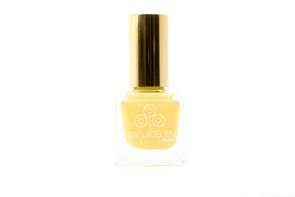 "<p><strong>Breukelen Polish</strong></p><p>bkpolished.com</p><p><strong>$11.00</strong></p><p><a href=""https://www.bkpolished.com/shopnailpolish/chill-son"" rel=""nofollow noopener"" target=""_blank"" data-ylk=""slk:Shop Now"" class=""link rapid-noclick-resp"">Shop Now</a></p><p>Want a jolt of bold and bright? This creamy yellow nail polish color from Breukelen Polish looks striking against chocolate skin tones, and is <strong>especially fun with a warm-weather pedicure</strong>. </p>"