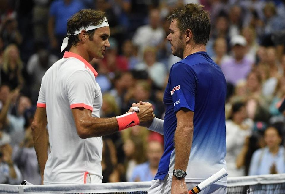 Roger Federer shakes hands with Stan Wawrinka after beating him in their 2015 US Open Men's Singles semifinals in New York on September 11, 2015 (AFP Photo/Timothy A. Clary)