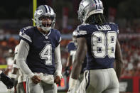 Dallas Cowboys quarterback Dak Prescott (4) celebrates with wide receiver CeeDee Lamb (88) after a touchdown against the Tampa Bay Buccaneers during the first half of an NFL football game Thursday, Sept. 9, 2021, in Tampa, Fla. (AP Photo/Mark LoMoglio)