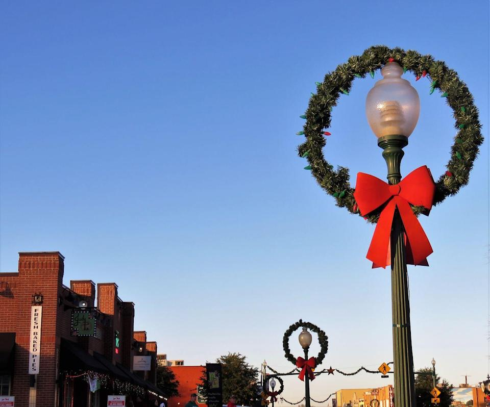 """<p>Grapevine, a.k.a the <a href=""""https://www.grapevinetexasusa.com/christmas-capital-of-texas/"""" rel=""""nofollow noopener"""" target=""""_blank"""" data-ylk=""""slk:Christmas Capital of Texas"""" class=""""link rapid-noclick-resp"""">Christmas Capital of Texas</a>, hosts 1,400 events in 40 days throughout the holiday season, making it second-best only to the actual North Pole. At Christmastime, Grapevine's vintage railroad becomes the North Pole Express, which entertains passengers with caroling elves, Santa's Frosty Chocolate Snow Milk, an appearance by Mrs. Claus, and a stroll through the North Pole Forest, complete with a Broadway-style show. Adults can hop aboard the Christmas Wine Train for red and white wines from Texas wineries and hors d'oeuvres. You can also catch Grapevine's lighting ceremonies, live music, fireworks, festive foods, boat parade, and even a few photo ops with live reindeer. </p>"""