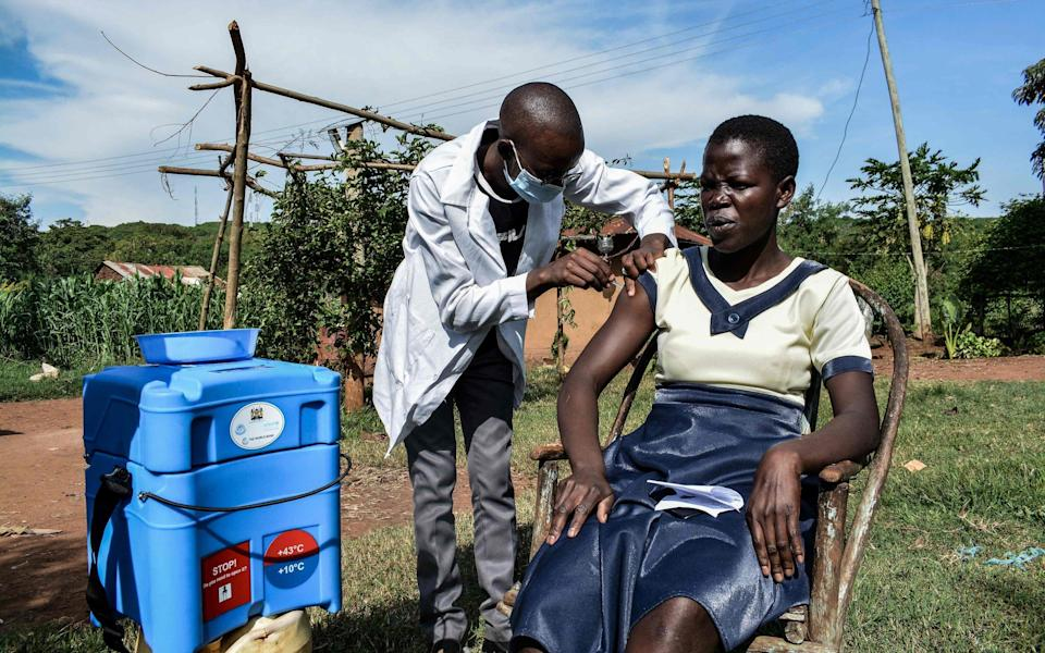 A medical health worker administers the AstraZeneca vaccine during a door-to-door visit to deliver the vaccines to people who live far from health facilities in Siaya, Kenya - BRIAN ONGORO/AFP