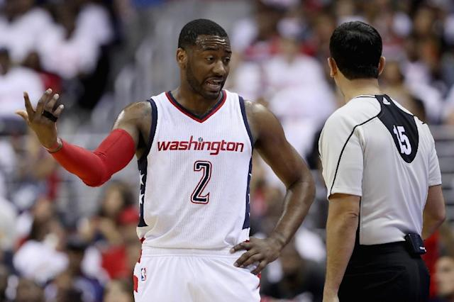 John Wall of the Washington Wizards talks to an official in the first half against the Atlanta Hawks in Game One of the Eastern Conference quarter-finals during the 2017 NBA Playoffs, in Washington, DC, on April 16 (AFP Photo/Rob Carr)