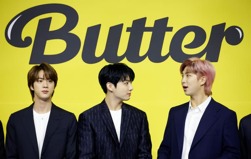K-pop boy band BTS member RM, Jung Kook and Jin pose for photographs during a photo opportunity promoting their new single 'Butter' in Seoul