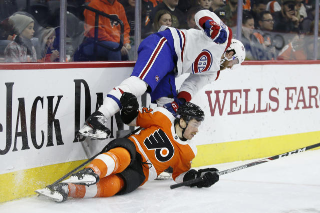 Philadelphia Flyers' Michael Raffl, bottom, and Montreal Canadiens' Jeff Petry collide during the second period of an NHL hockey game, Thursday, Nov. 7, 2019, in Philadelphia. (AP Photo/Matt Slocum)
