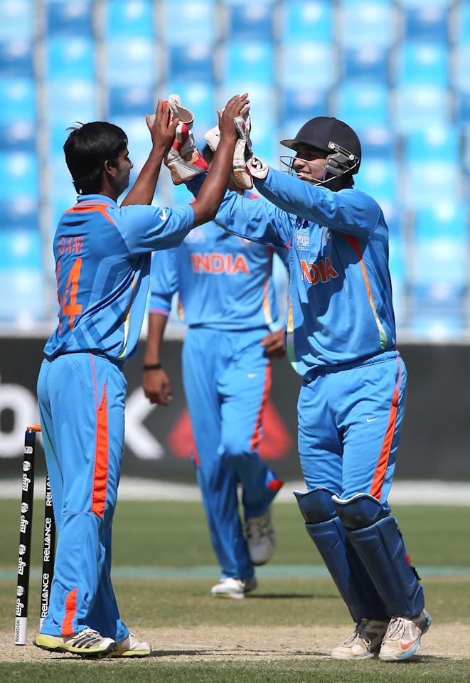 DUBAI, UNITED ARAB EMIRATES - FEBRUARY 17:  Aamir Ghani (L) and Ankush Bains (R) of India celebrate during the ICC U19 Cricket World Cup 2014 match between India and Scotland at the Dubai Sports City Cricket Stadium on February 17, 2014 in Dubai, United Arab Emirates.  (Photo by Francois Nel - IDI/IDI via Getty Images)