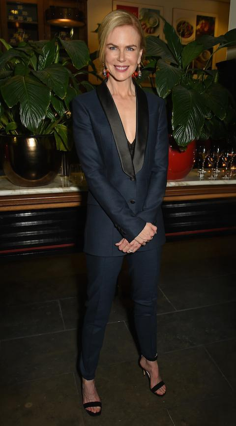 Taking her style cues from the classic Yves Saint Laurent Le Smoking, Nicole is perfect poised at an event in London.