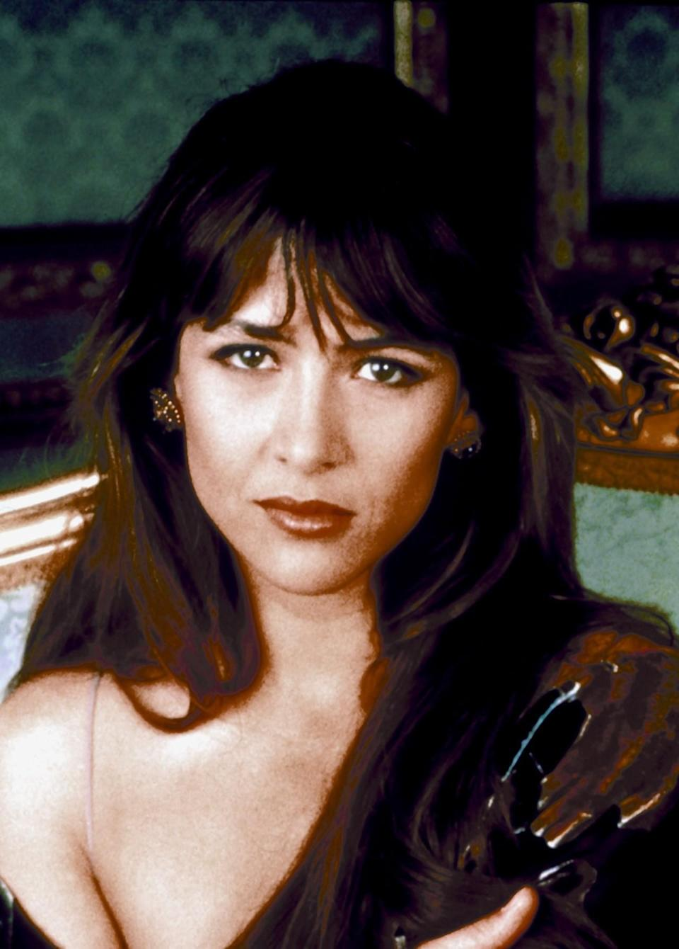 <p>This oil heiress and kidnapping victim is a target of the world's biggest terrorist. Her deceased father was a friend of M, so Bond is assigned to protect her, but she's not as innocent as she seems.<i> Photo: Everett Collection</i><br></p>