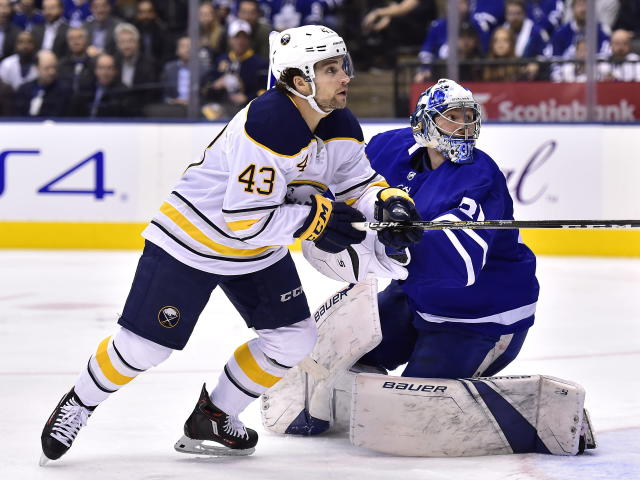 Toronto Maple Leafs goaltender Frederik Andersen (31) and Buffalo Sabres left wing Conor Sheary (43) watch the puck in the air during the third period of an NHL hockey game, Monday, Feb. 25, 2019 in Toronto. (Frank Gunn/The Canadian Press via AP)