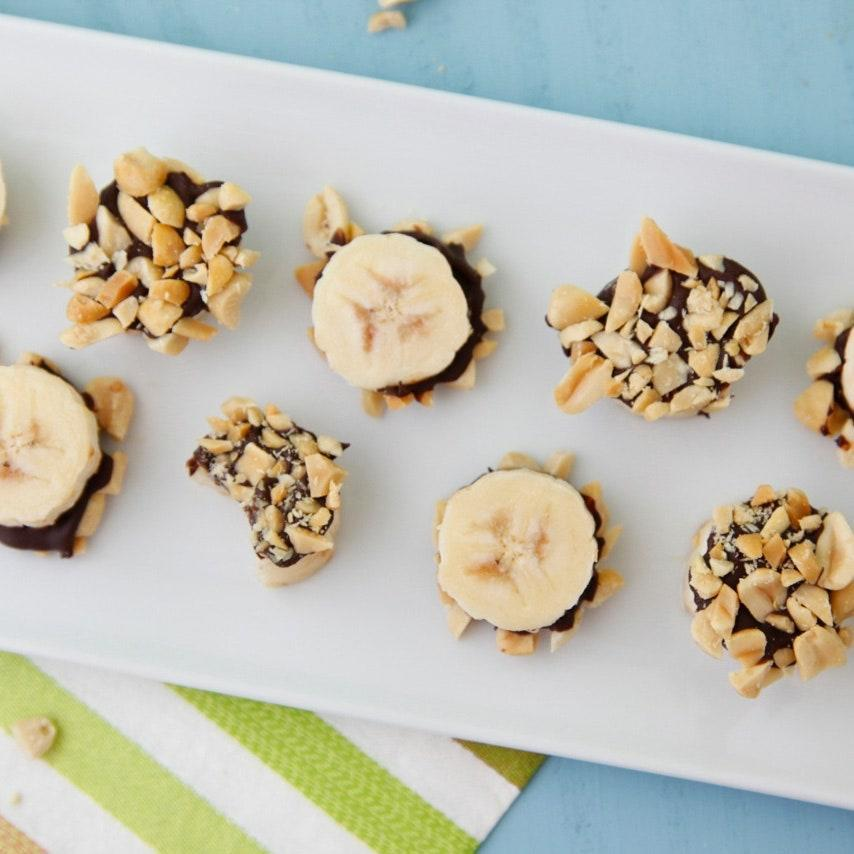 """Looking for a bite-size dessert that brings sweetness and a crunch? Look no further than these easy-to-make frozen bites that are even easier to eat. <a href=""""https://www.epicurious.com/recipes/food/views/chocolate-banana-bites-51262430?mbid=synd_yahoo_rss"""" rel=""""nofollow noopener"""" target=""""_blank"""" data-ylk=""""slk:See recipe."""" class=""""link rapid-noclick-resp"""">See recipe.</a>"""