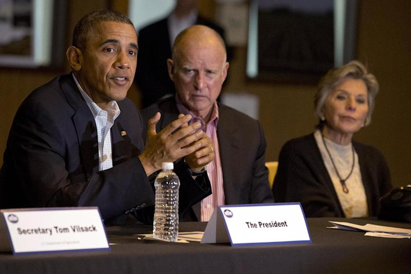 President Barack Obama, left, speaks during a roundtable with community leaders including California Gov. Jerry Brown, and Sen. Barbara Boxer, D-Calif., at San Luis Water Facility in Firebaugh, Calif., Friday, Feb. 14, 2014, regarding the ongoing drought. (AP Photo/Jacquelyn Martin)