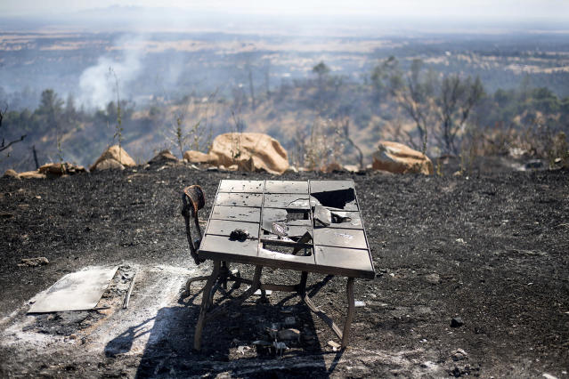 <p>A charred desk rests outside a residence after a wildfire burned through the property on Saturday, July 8, 2017, near Oroville, Calif. The fast-moving wildfire in the Sierra Nevada foothills destroyed structures, including homes, and led to several minor injuries, fire officials said Saturday as blazes threatened homes around California during a heat wave. (AP Photo/Noah Berger) </p>