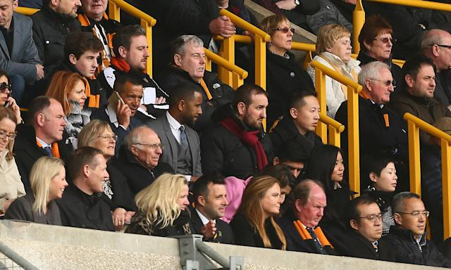Jorge Mendes (centre on phone) acts as an adviser to the Wolverhampton Wanderers board.
