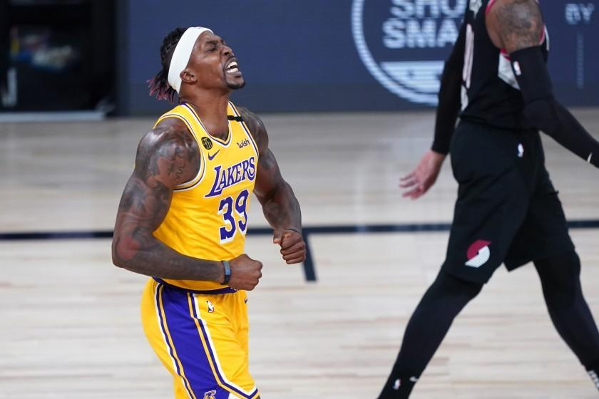 Los Angeles Lakers center Dwight Howard (39) reacts after a slam dunk during the first half of an NBA basketball game against the Portland Trail Blazers Tuesday, Aug. 18, 2020, in Lake Buena Vista, Fla. (AP Photo/Ashley Landis, Pool)