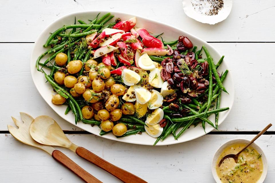 "This version of the classic French salad doesn't have any meat or fish, but it's got tons of flavor—the crispy fried capers are a particularly ingenious addition. <a href=""https://www.epicurious.com/recipes/food/views/green-bean-nicoise-salad?mbid=synd_yahoo_rss"" rel=""nofollow noopener"" target=""_blank"" data-ylk=""slk:See recipe."" class=""link rapid-noclick-resp"">See recipe.</a>"