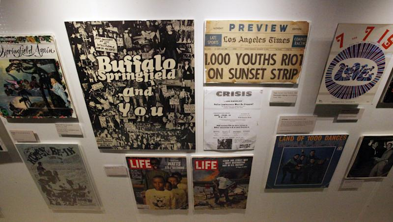 """This March 26, 2012 photo shows a portion of the exhibit, """"Trouble In Paradise: Music and Los Angeles, 1945-1975,"""" at the Grammy Museum in downtown Los Angeles. The museum website says the exhibit focuses on the """"tensions between alluring myths of Southern California paradise and the realities of social struggle that characterized the years following WWII."""" (AP Photo/Reed Saxon)"""