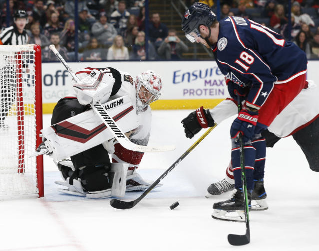 Arizona Coyotes' Darcy Kuemper, left, makes a save against Columbus Blue Jackets' Pierre-Luc Dubois during the second period of an NHL hockey game Tuesday, Dec. 3, 2019, in Columbus, Ohio. (AP Photo/Jay LaPrete)