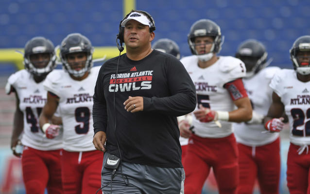 Florida Atlantic's defensive coordinator Chris Kiffin, brother of head coach Lane Kiffin, takes the field for his first college football spring game at the school in Boca Raton, Fla., Saturday, April 22, 2017. (Jim Rassol/South Florida Sun-Sentinel via AP)