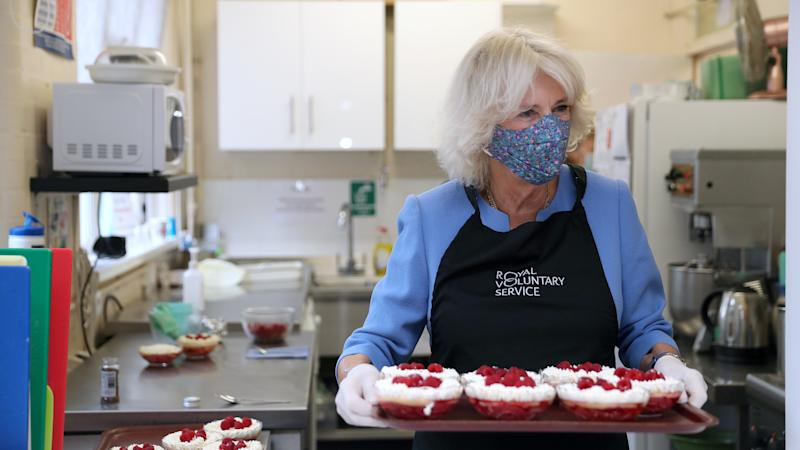 Camilla praises volunteers as she serves lunch to pensioners
