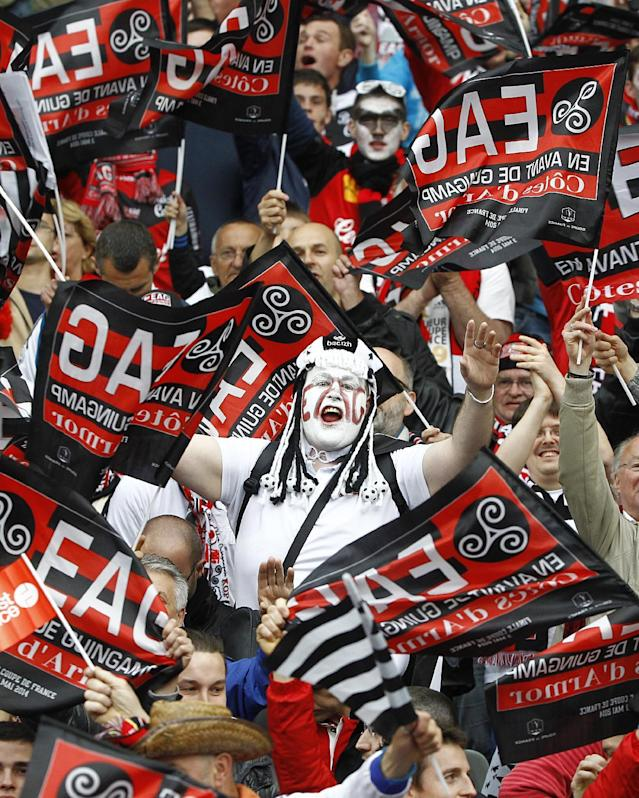 Guingamp supporters wave flags and chant slogans in the stands of of the Stade de France, before the start of the French Cup final match between Guingamp and Rennes at the Stade de France Stadium, in Saint Denis, North of Paris, Saturday, May 3, 2014. (AP Photo/Remy de la Mauviniere)