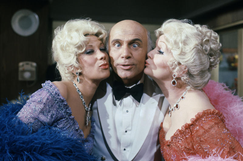 """FILE - This Oct. 15, 1982 file photo shows Gavin MacLeod, center, with actress Debbie Reynolds, right, and Marilyn Michaels as special guest stars on ABC's """"Love Boat."""" Debbie Reynolds and Marilyn Michaels are dressed impersonating Zsa Zsa Gabor. (AP Photo/Doug Pizac, File)"""