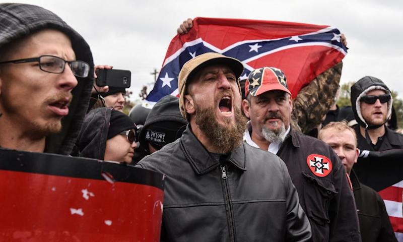 """Participants in a """"White Lives Matter"""" rally in Shelbyville, Tennessee, on 28 October. A woman has alleged that a group of white nationalists assaulted her after the march."""