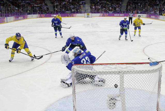 Sweden forward Loui Eriksson shoots and scores a goal against Slovenia goaltender Robert Kristan in the third period of a men's quarterfinal ice hockey game at the 2014 Winter Olympics, Wednesday, Feb. 19, 2014, in Sochi, Russia. (AP Photo/Mark Humphrey)