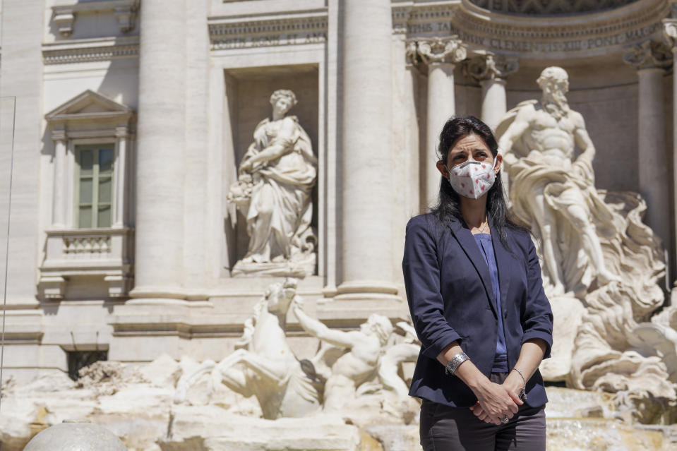 Rome's Mayor Virginia Raggi attends a press conference to present a new electric scooters sharing service, in front of Rome's Trevi Fountain, Thursday, May 28, 2020. Alternative means of transport are being promoted in Italy's major metropolitan areas following public transports' restrictions that have been set for containing the COVID-19 spread. (AP Photo/Andrew Medichini)