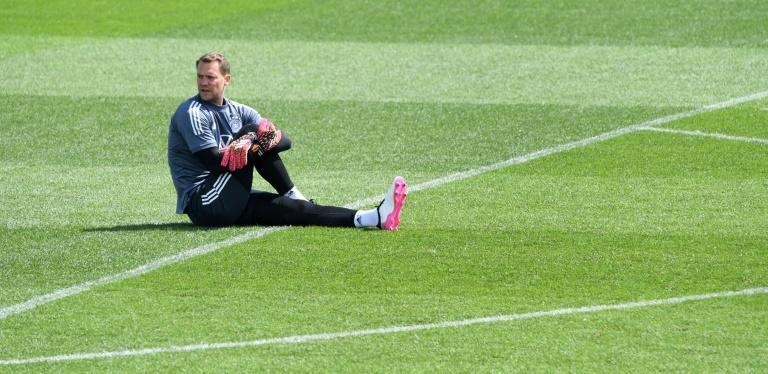 Germany goalkeeper Manuel Neuer warms up before Sunday's session in Herzogenaurach