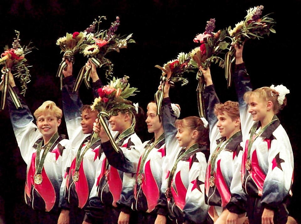 <p>The members of the Magnificent Seven stand proudly on the Olympic podium after being awarded their gold medals in the team competition at the 1996 Games. From left to right, the team was composed of Amanda Borden, Dominique Dawes, Amy Chow, Jaycie Phelps, Dominique Moceanu, Kerri Strug and Shannon MIller. (AP) </p>